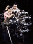 Picture of a Man and Woman Working on an Airplane Engine