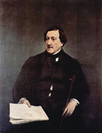 Photo of Gioachino Antonio Rossini Seated With Sheet Music