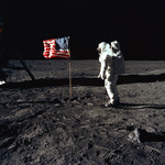 Stock Picture of Astronaut Buzz Aldrin by an American Flag on the Moon