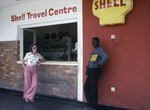 Man and Woman Standing Outside of a Shell Gas Station Where Two People Became Ill with the Marburg Virus