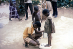 Nigerian Children Being Weighed On a Scale