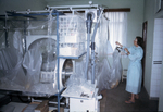 South African Virologist Adjusting Plastic Ebola Virus Isolators