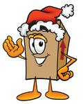 Clip Art Graphic of a Cardboard Shipping Box Cartoon Character Wearing a Santa Hat and Waving