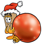 Clip Art Graphic of a Cardboard Shipping Box Cartoon Character Wearing a Santa Hat, Standing With a Christmas Bauble