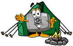 Clip Art Graphic of a Flash Camera Cartoon Character Camping With a Tent and Fire