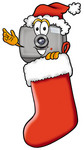 Clip Art Graphic of a Flash Camera Cartoon Character Wearing a Santa Hat Inside a Red Christmas Stocking