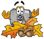 Clip Art Graphic of a Flash Camera Cartoon Character With Autumn Leaves and Acorns in the Fall
