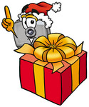 Clip Art Graphic of a Flash Camera Cartoon Character Standing by a Christmas Present