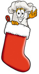 Clip Art Graphic of a White Chefs Hat Cartoon Character Inside a Red Christmas Stocking