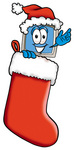 Clip Art Graphic of a Desktop Computer Cartoon Character Wearing a Santa Hat Inside a Red Christmas Stocking