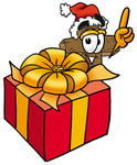 Clip Art Graphic of a Wooden Cross Cartoon Character Standing by a Christmas Present