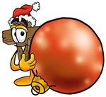 Clip Art Graphic of a Wooden Cross Cartoon Character Wearing a Santa Hat, Standing With a Christmas Bauble