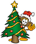 Clip Art Graphic of a Wooden Cross Cartoon Character Waving and Standing by a Decorated Christmas Tree