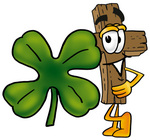 Clip Art Graphic of a Wooden Cross Cartoon Character With a Green Four Leaf Clover on St Paddy's or St Patricks Day