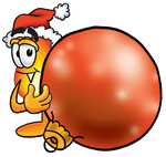 Clip Art Graphic of a Fire Cartoon Character Wearing a Santa Hat, Standing With a Christmas Bauble