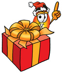 Clip Art Graphic of a Fire Cartoon Character Standing by a Christmas Present