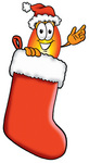 Clip Art Graphic of a Fire Cartoon Character Wearing a Santa Hat Inside a Red Christmas Stocking