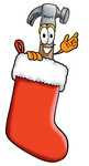 Clip Art Graphic of a Hammer Tool Cartoon Character Inside a Red Christmas Stocking