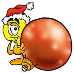 Clip Art Graphic of a Yellow Electric Lightbulb Cartoon Character Wearing a Santa Hat, Standing With a Christmas Bauble