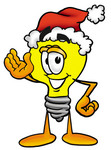 Clip Art Graphic of a Yellow Electric Lightbulb Cartoon Character Wearing a Santa Hat and Waving