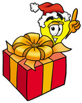 Clip Art Graphic of a Yellow Electric Lightbulb Cartoon Character Standing by a Christmas Present
