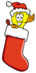 Clip Art Graphic of a Yellow Electric Lightbulb Cartoon Character Wearing a Santa Hat Inside a Red Christmas Stocking