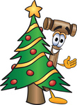 Clip Art Graphic of a Wooden Mallet Cartoon Character Waving and Standing by a Decorated Christmas Tree
