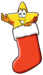 Clip Art Graphic of a Yellow Star Cartoon Character Inside a Red Christmas Stocking