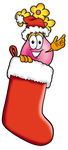 Clip Art Graphic of a Pink Vase And Yellow Flowers Cartoon Character Wearing a Santa Hat Inside a Red Christmas Stocking