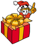 Clip Art Graphic of a Red Paintbrush With Yellow Paint Cartoon Character Standing by a Christmas Present