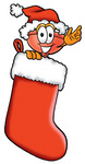 Clip Art Graphic of a Plumbing Toilet or Sink Plunger Cartoon Character Wearing a Santa Hat Inside a Red Christmas Stocking