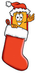 Clip Art Graphic of a Red and Yellow Sales Price Tag Cartoon Character Wearing a Santa Hat Inside a Red Christmas Stocking