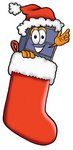 Clip Art Graphic of a Suitcase Luggage Cartoon Character Wearing a Santa Hat Inside a Red Christmas Stocking