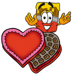 Clip Art Graphic of a Red Paintbrush With Yellow Paint Cartoon Character With an Open Box of Valentines Day Chocolate Candies