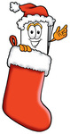Clip Art Graphic of a White Copy and Print Paper Cartoon Character Wearing a Santa Hat Inside a Red Christmas Stocking