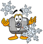Clip Art Graphic of a Flash Camera Cartoon Character Surrounded by Snowflakes in Winter