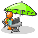 Clip Art Graphic of an Orange Guy Character Working At A Patio Table On A Laptop
