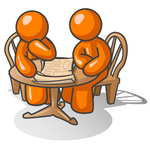 Clip Art Graphic of an Orange Guy Character And Friend Sitting At A Table And Looking At Papers
