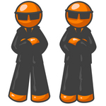 Clip Art Graphic of Two Orange Guy Characters In Black Suits And Shades, Standing Still With Their Arms Crossed