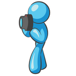 Clip Art Graphic of a Sky Blue Guy Character Taking Pictures
