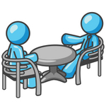 Clip Art Graphic of a Sky Blue Guy Character Chatting With a Friend at a Table
