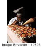 #10603 Picture Of A Man Frosting Cakes