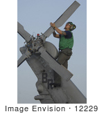 #12229 Picture Of A Soldier During Corrosion Maintenance On A Military Helicopter