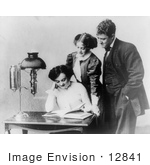 #12841 Picture Of Two Woman And A Man Reading A Book By A Lamp