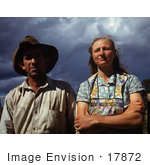#17872 Photo Of A Farmer Husband And Wife Against A Stormy Sky