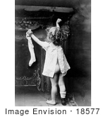 #18577 Photo Of A Little Girl Child Showing Her Behind As She Reaches Up To Hang A Stocking On Christmas