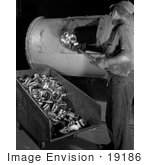 #19186 Photo Of A Male Factory Worker Putting Duds Back Into A Furnace For Recasting