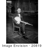 #20819 Stock Photography of a Man Sitting in a Chair and Resting a Banjo on His Lap by JVPD