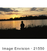 #21550 Sports Stock Photography Of Man Silhouetted While Fishing Against An Orange Sunset