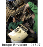 #21697 Stock Photography Of United States Navy Men Removing An Electrical Generator From A F/A-18c Hornet
